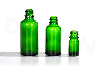 GREEN GLASS HOMEOPATHIC BOTTLES